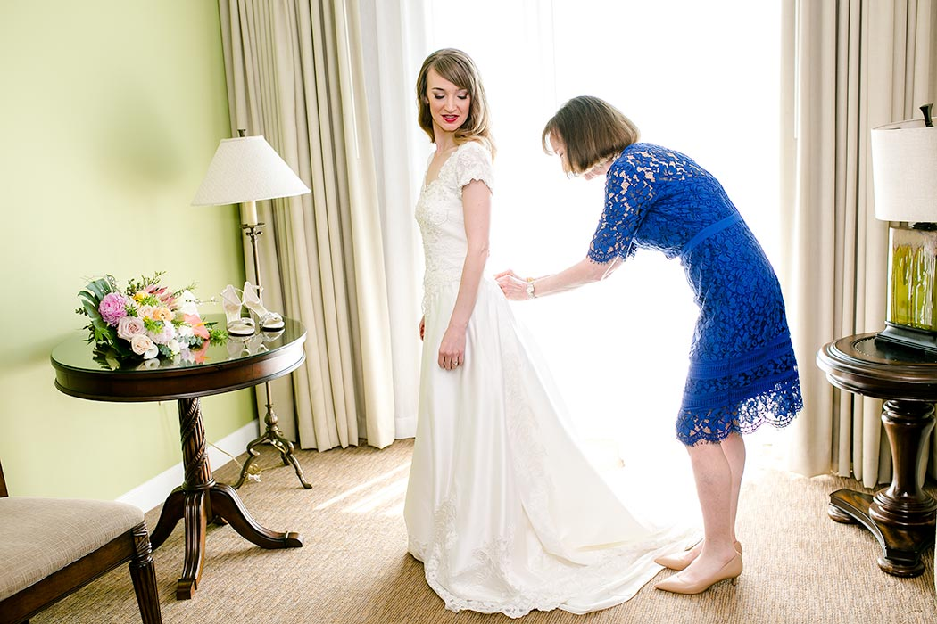 bride getting ready on wedding day | photo of mother of bride assisting bride getting ready | vintage wedding dress | modern wedding in fort lauderdale