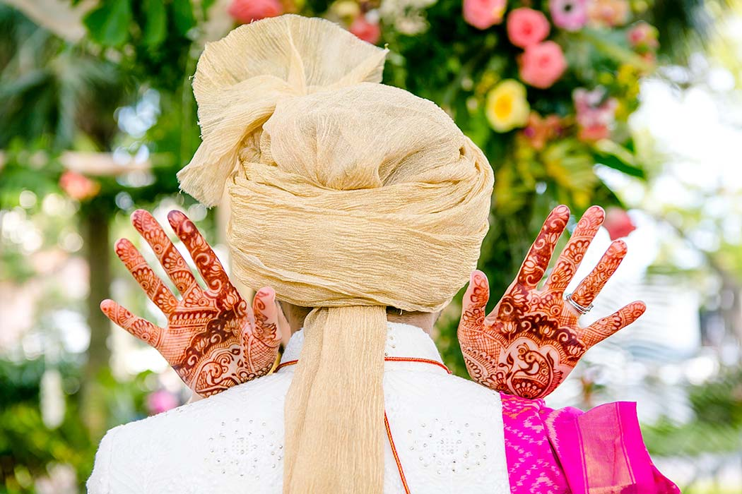 unique bridal henna image | indian bride and groom unique posing | indian brides shows henna behind indian groom