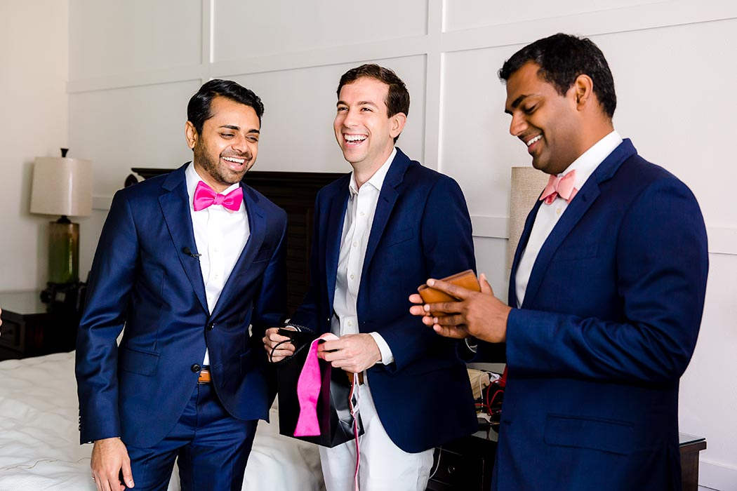 indian wedding in fort lauderdale | indian fusion wedding fort lauderdale | indian groom getting ready | navy blue wedding suit pink bow tie | photograph of groom and groomsmen