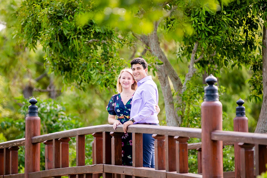 couple on bridge in morikami japanese gardens during engagement photoshoot | engagement pictures on bridge in morikami | fort lauderdale engagement photographer