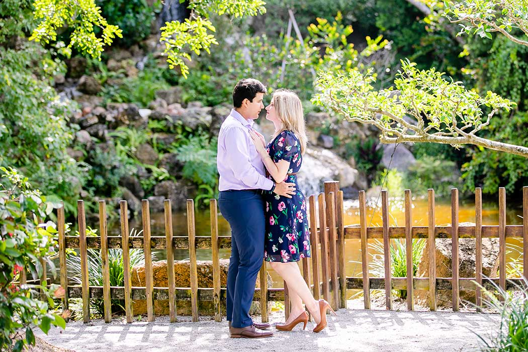 engagement photoshoot at morikami japanese gardens | couple posing for engagement at morikami | morikami engagement photo