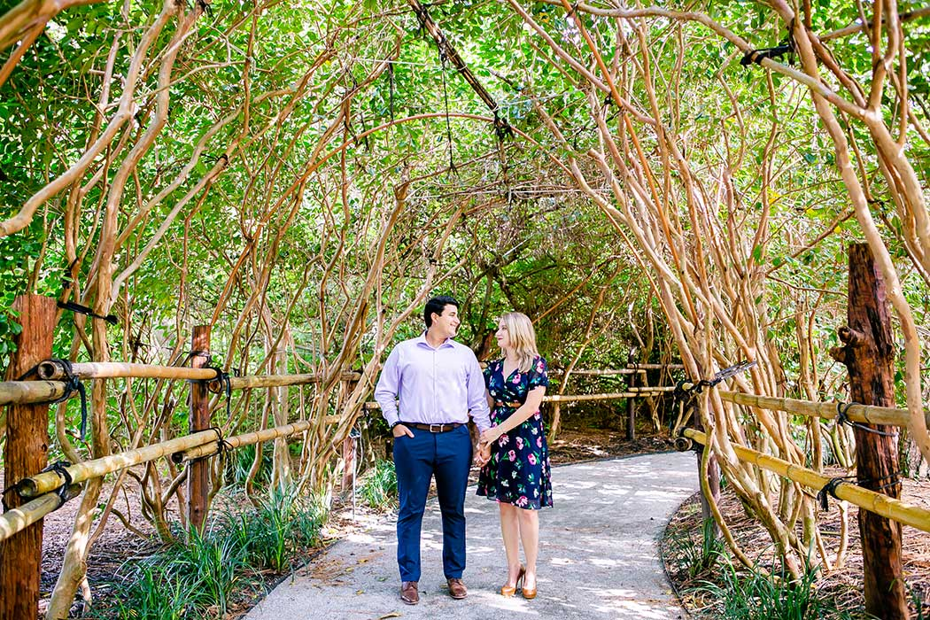 morikami japenese gardens engagement session | engagement photographs at morikami | south florida engagement photos | unique pose for engagement photography in bamboo garden | couple holding hands during engagement photos in flort lauderdale