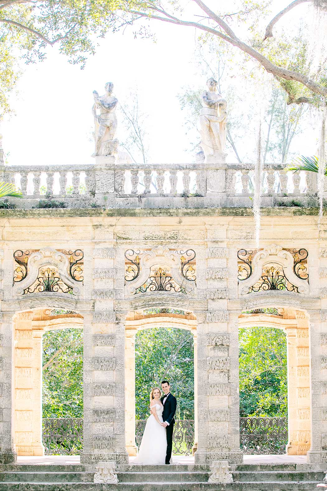 vizcaya museum + gardens engagement photography session | couple pose in vizcaya gardens for photoshoot | vizcaya museum engagement photos