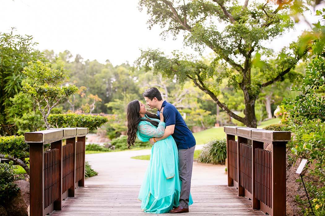 romantic couples photoshoot at morikami | couple pose on bridge at morikami for engagement photos | engagement photographer fort lauderdale