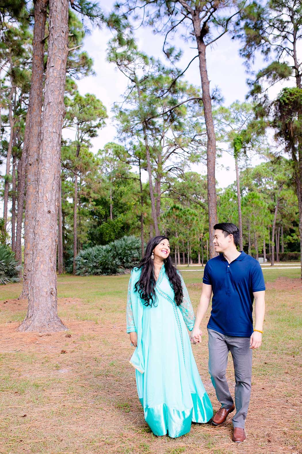 couple walking through trees at morikami | park engagement session south florida | south florida engagement photographer | fort lauderdale engagement photographer