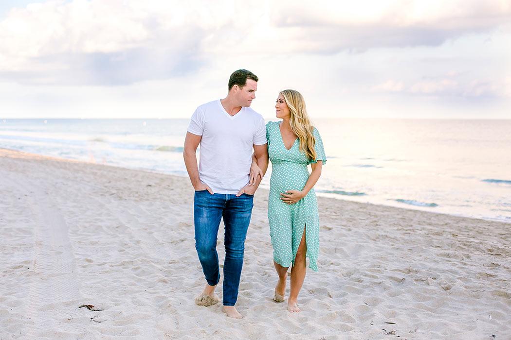 walking beach maternity shot | couple walk on fort lauderdale beach during maternity photoshoot | fort lauderdale beach maternity photographer