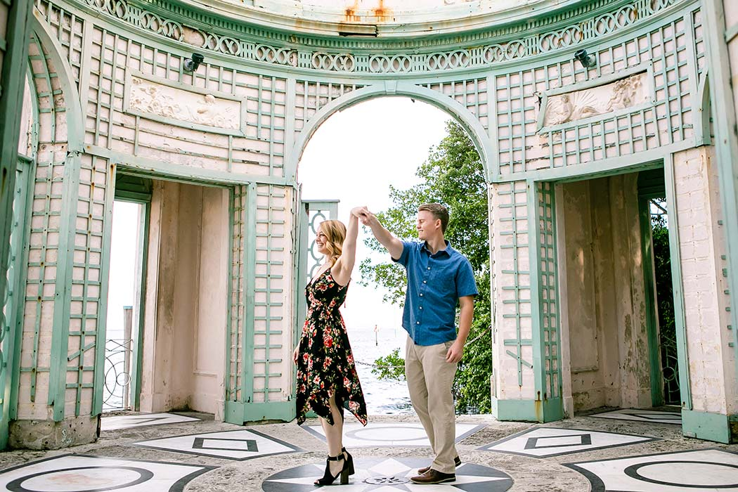 engagement photography at vizcaya | couple pose for engagement photos in tea house at vizcaya | beautiful vizcaya photoshoot