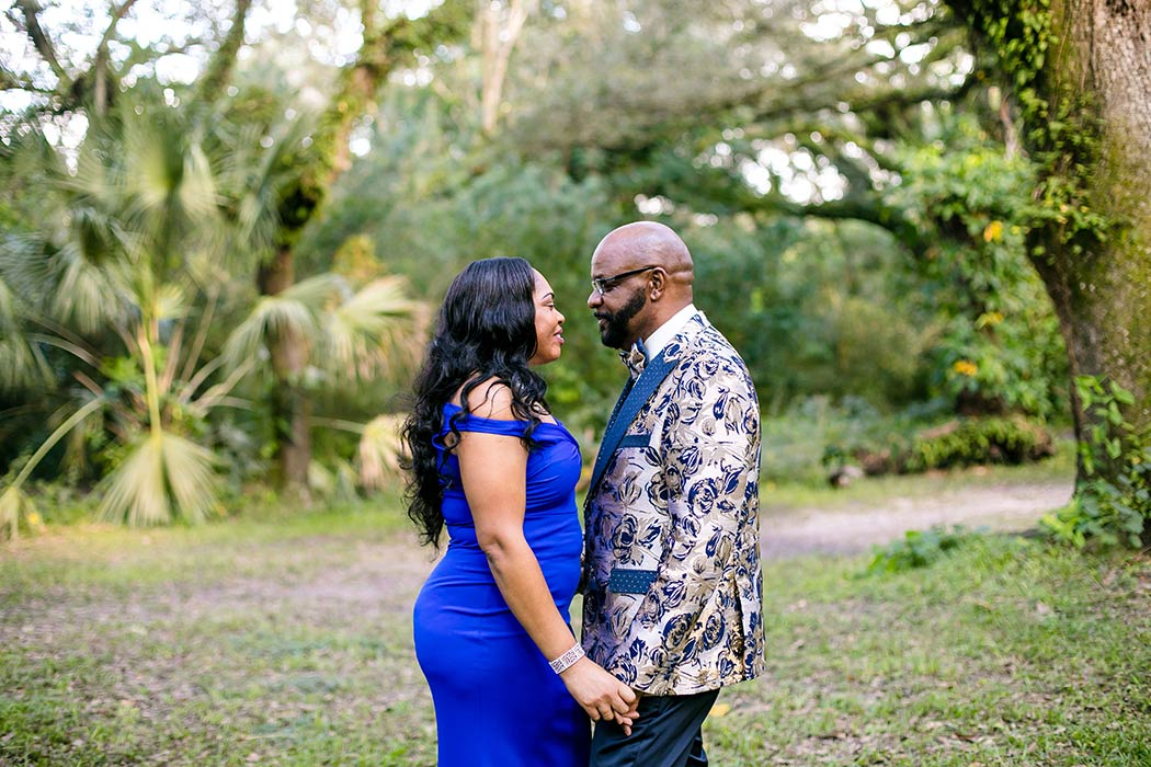 photograph of couple embracing during couples' photoshoot | romantic couples' photography | tree tops park engagement photos | tree tops park photography
