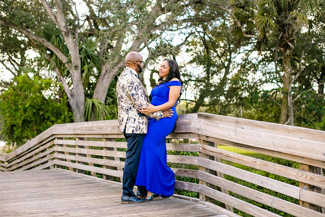 black couple pose for tree tops park photos | engagement photoshoot tree tops park | formal attire for photography | black couples' photogrpahy pose