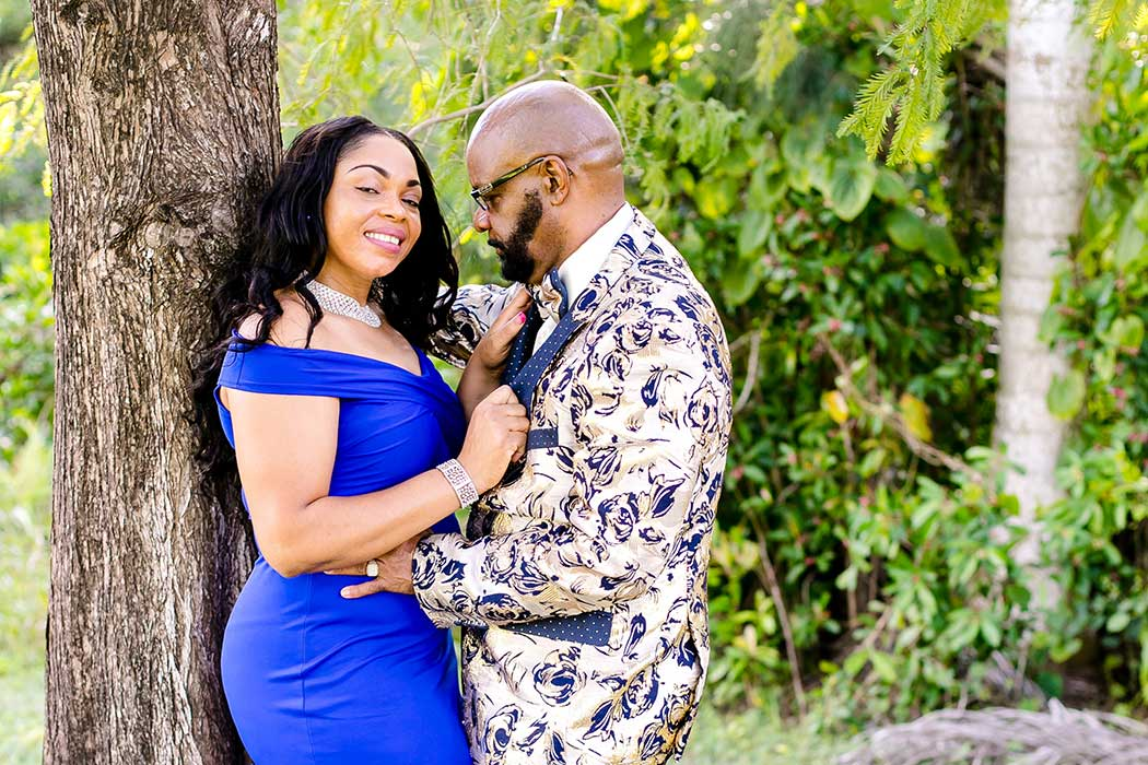 unique fun picture of engagement session in park with large tree | engagement photographer fort lauderdale | black couple engagement tree tops park photography