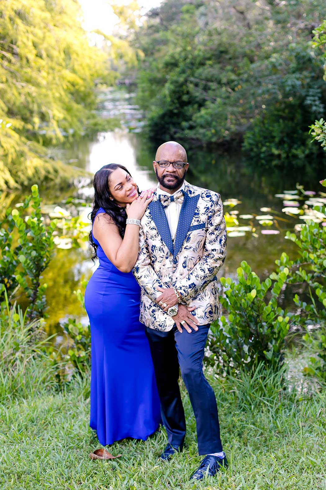 black couple embrace for fort lauderdale engagement photoshoot | black couple formal photos tree tops park | black couple pose for photographs