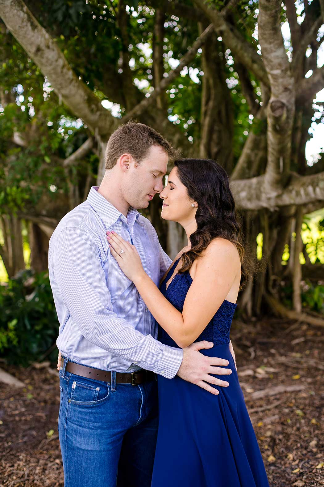unique fun picture of engagement session in park with large tree | engagement photographer fort lauderdale | south florida engagement photography in robbins preserve davie | elegant engagement session photos fort lauderdaley