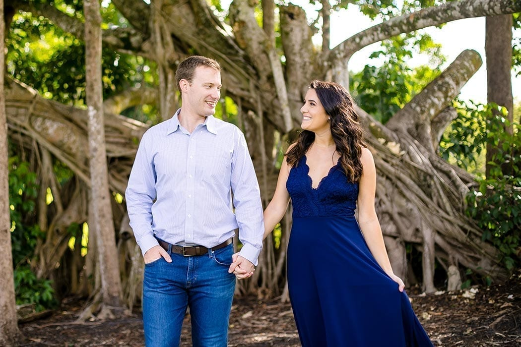 engaged couple pose for photos in robbins preserve | engagement photography in south florida
