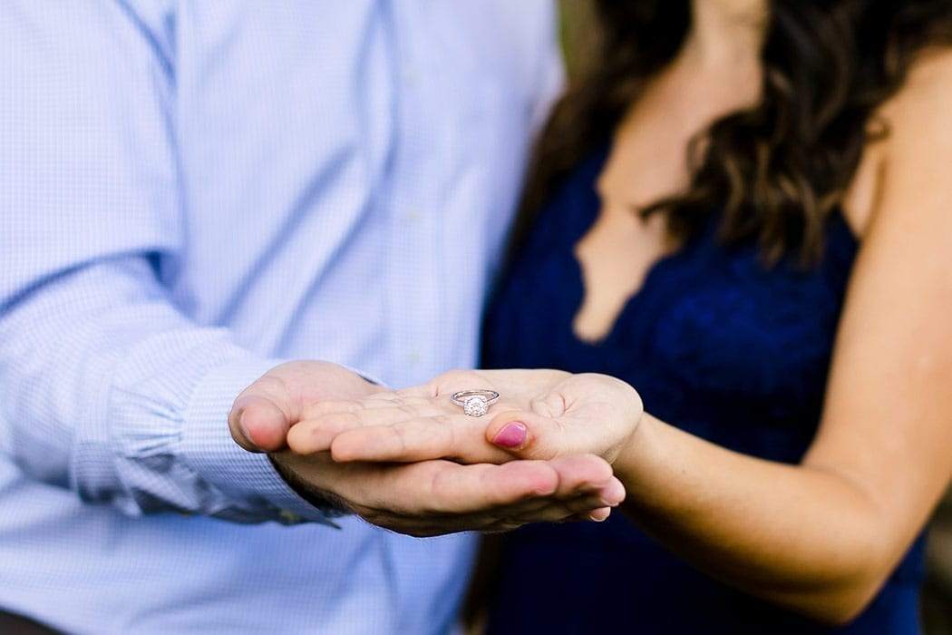 diamond engagement ring photo | diamond ring photo | photo idea for engagement ring | couple pose with ring in had for elegant engagement photoshoot in robbins preserve