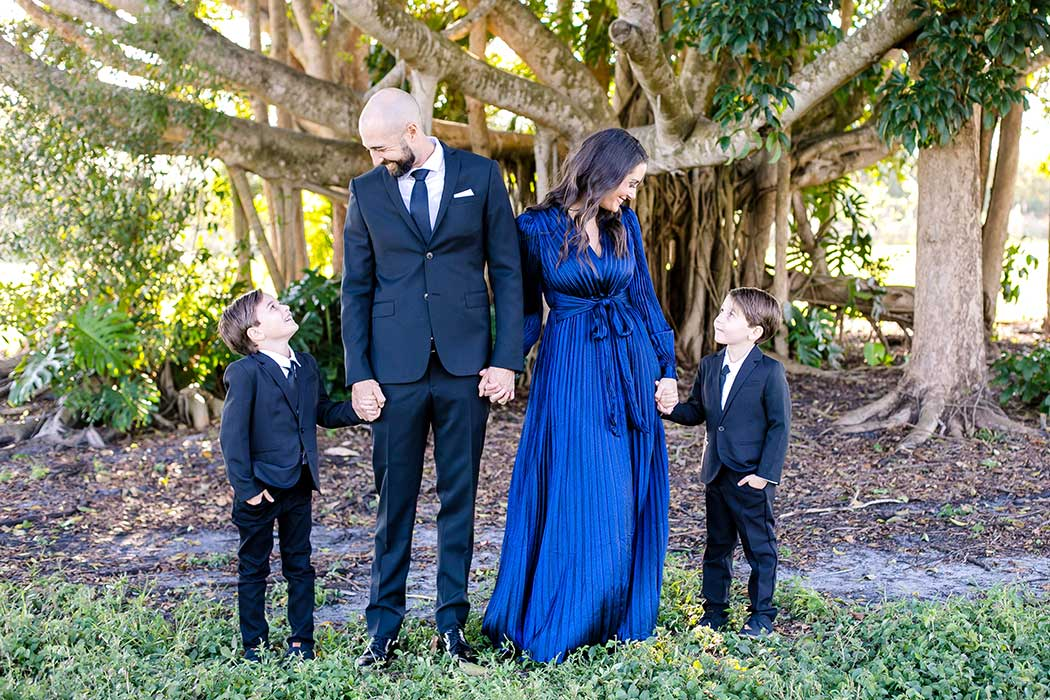 elegant family photoshoot robbins preserve | family of 4 holding hands | images of formal family photos in a park | family photographer fort lauderdale | south florida family photographer