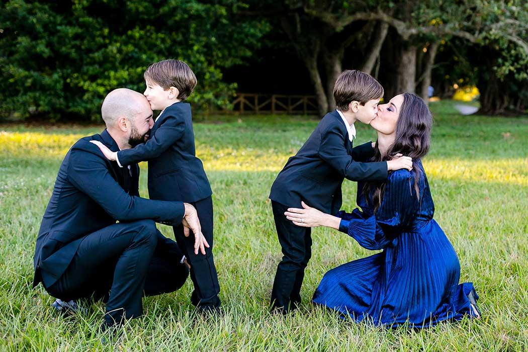 family kiss during photoshoot | south florida elegant family photography session | robbins preserve elegant family photoshoot