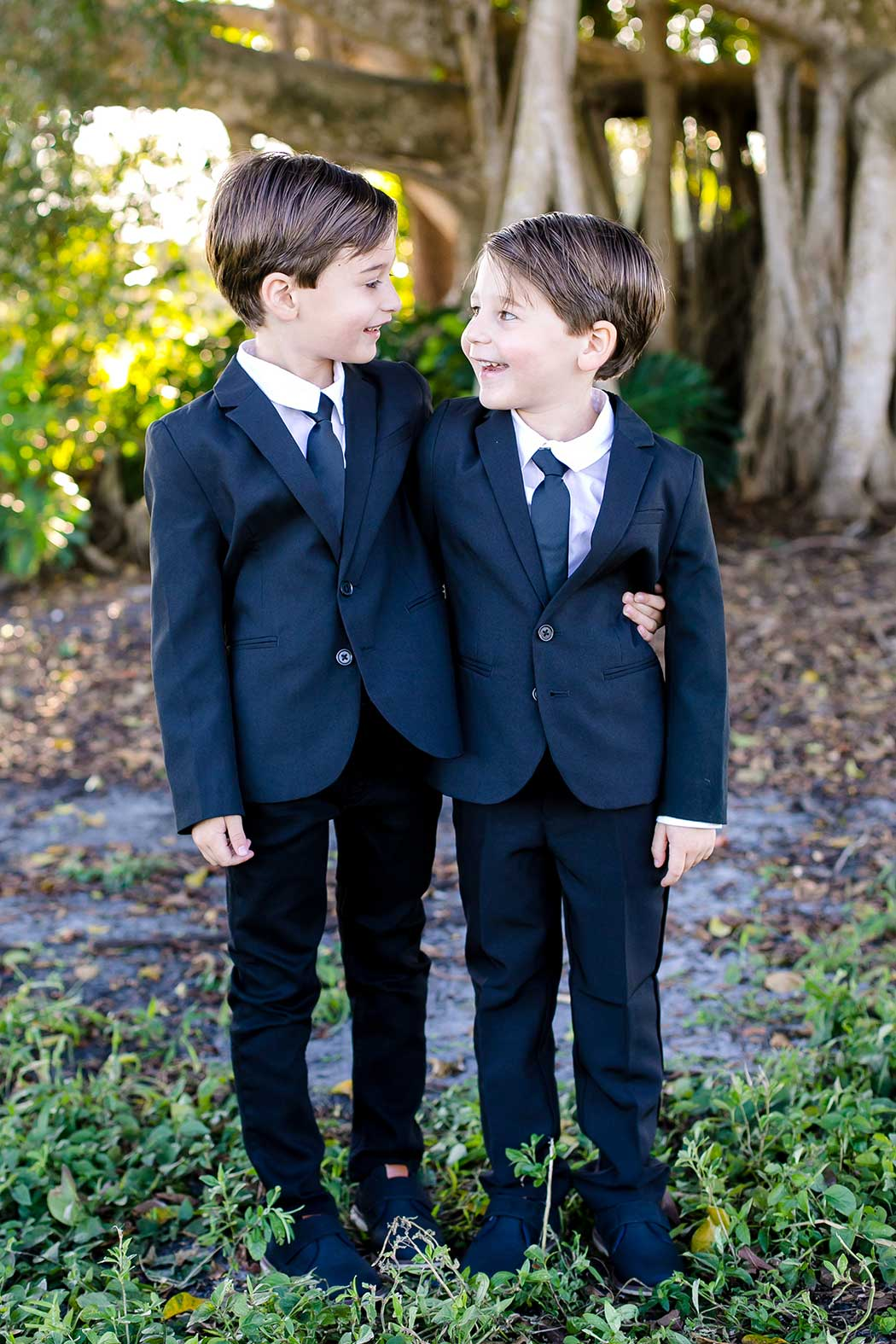 twin boys pose for photo | twin 5-year old boys photographs | family photo session fort lauderdale | family photographer robbins preserve fort lauderdale | elegant family photoshoot