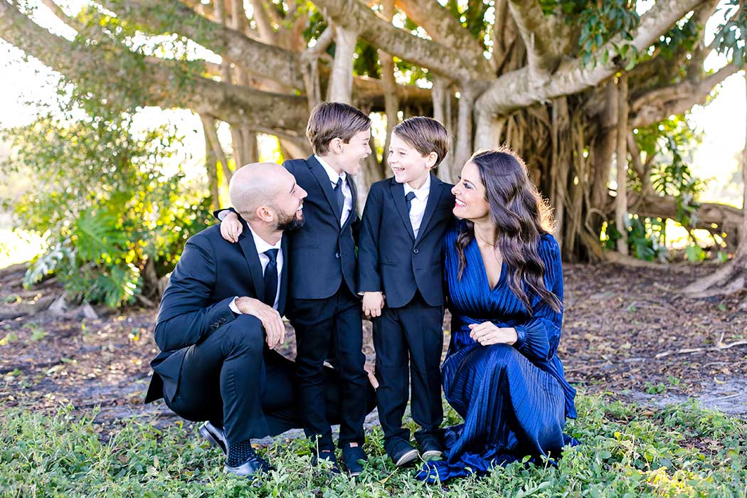 fun family pose for formal photography session | formal elegant family photography at robbins preserve | family 4 photography | family pose for 4 people