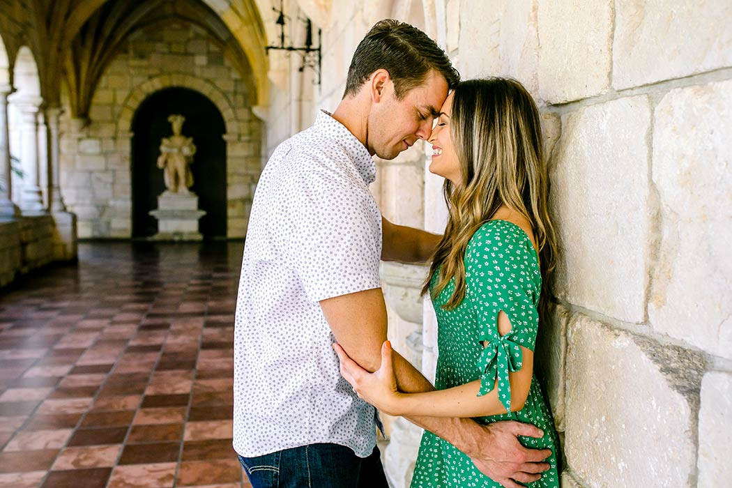 romantic photoshoot at ancient spanish monastery | couple pose for engagement photos | girl in green summer dress in miami | engagement photographer fort lauderdale | andrea harborne photography