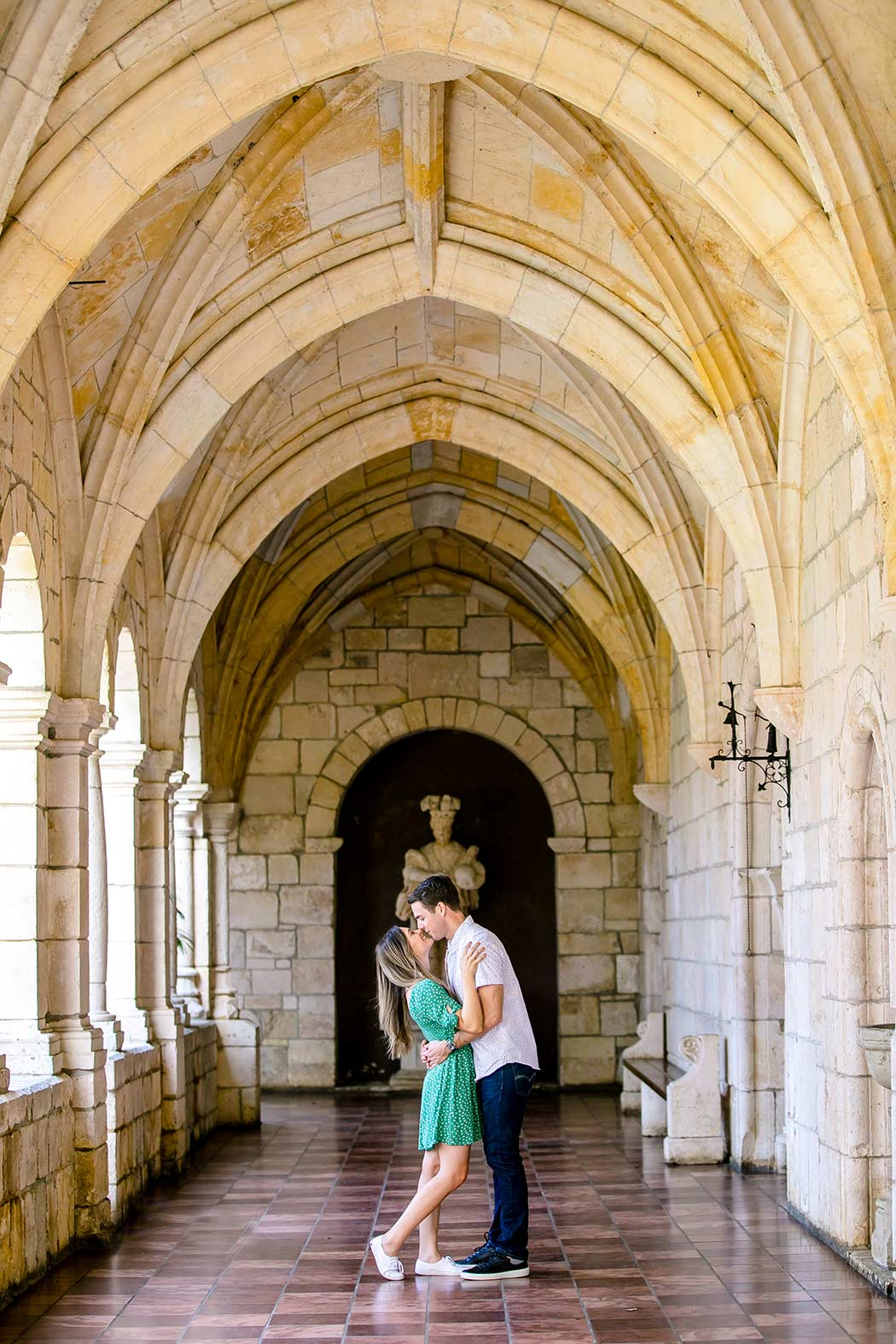 couple kissing in ancient spanish monastery, miami | andrea harborne photography | engagement photography fort lauderdale | fort lauderdale proposal photographs