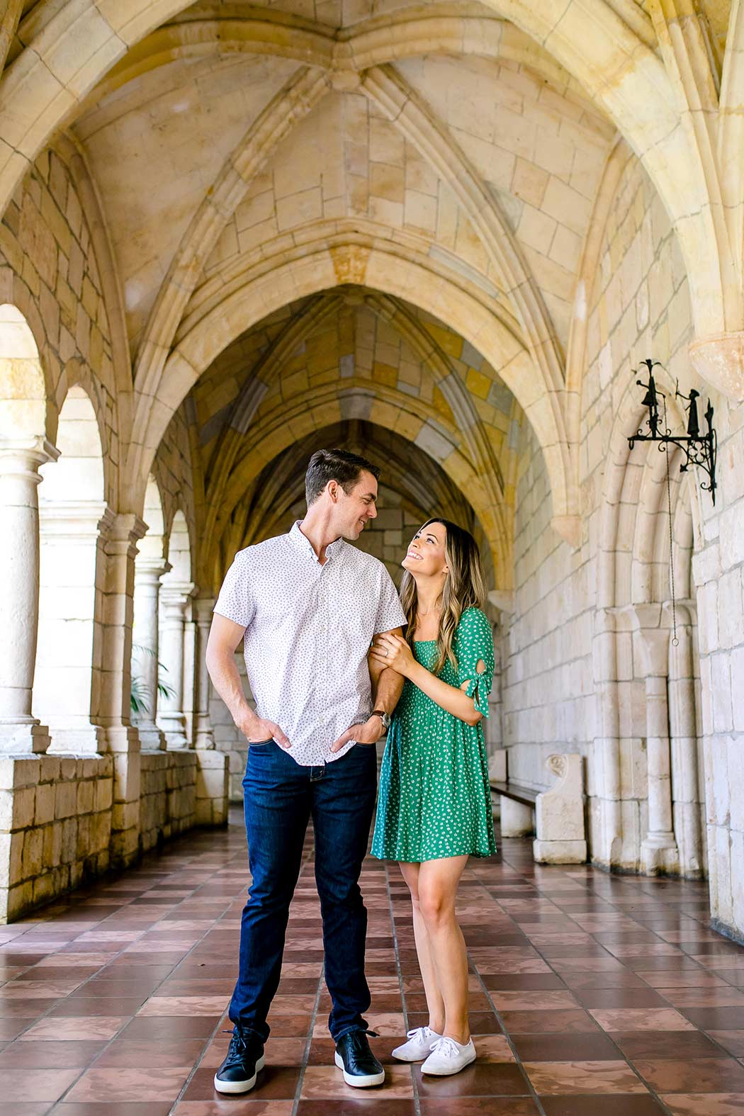 engagement photos inside spanish monastery miami | girl wearing green summer dress for engagement photos
