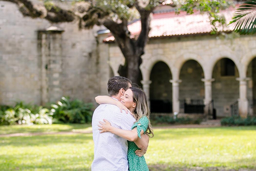 ancient spanish monastery miami | cuddling couple photo | fort lauderdale engagement photographer | couples photography spanish monastery