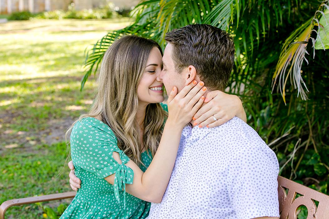 couple posing on bench in garden of ancient spanish monastery | engagement photography pictures | recently engaged couple
