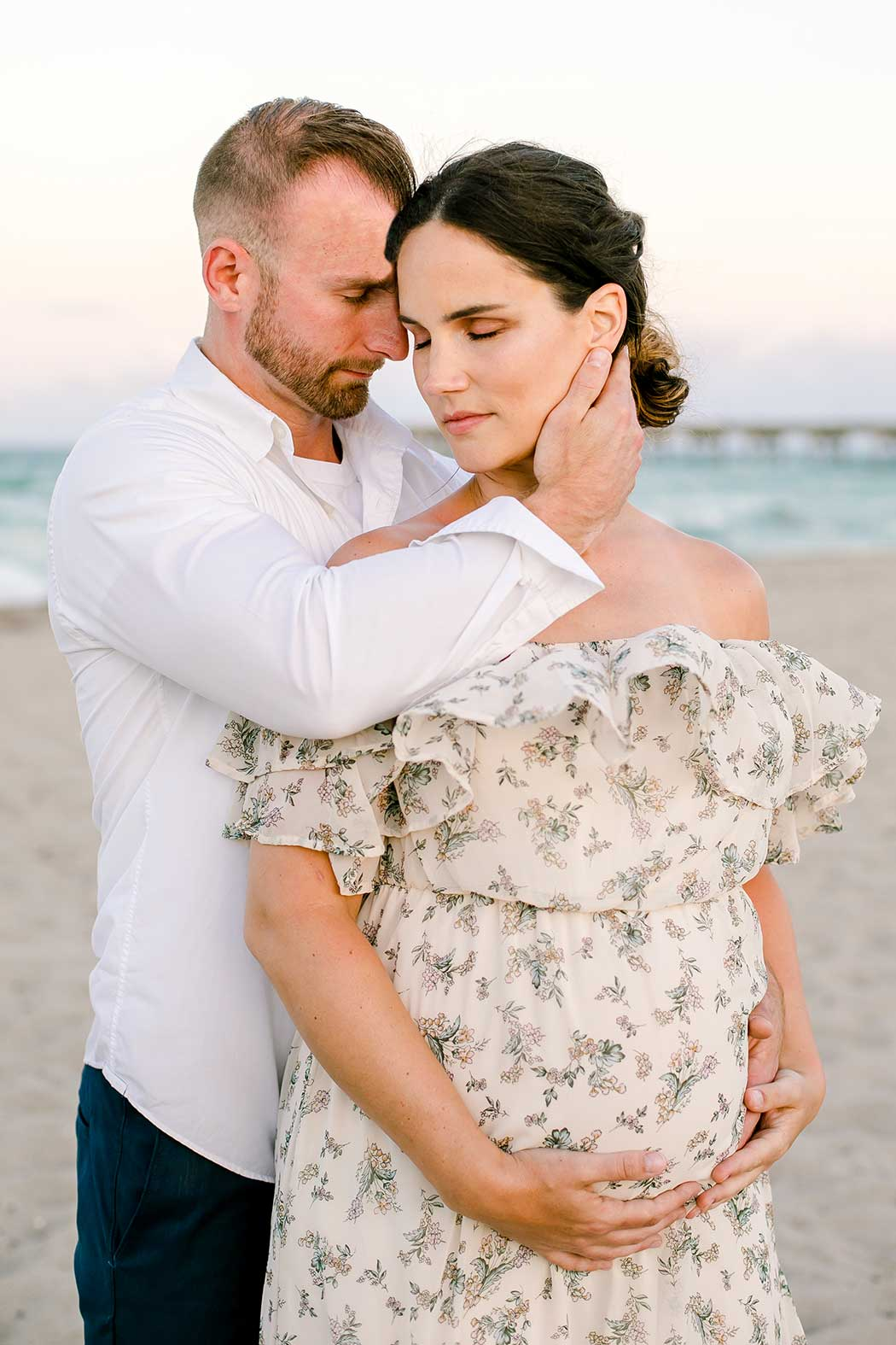 husband and wife maternity pose idea | romantic pose for maternity photography with two people | husband and wife maternity photoshoot on dania beach