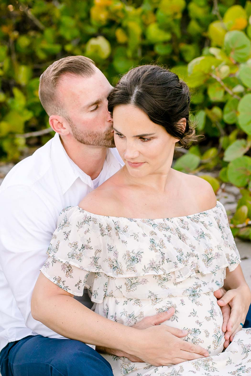 dania beach family maternity photoshoot with couple | beach maternity pictures | fort lauderdale maternity photographer | husband kisses wife during maternity photography