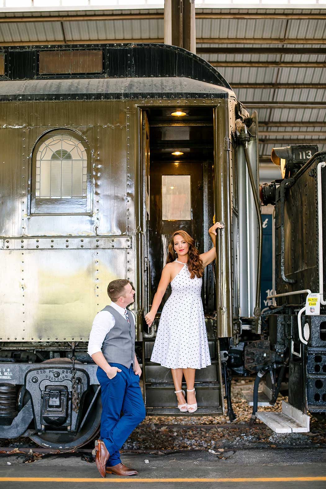 posing ideas on a train   engagement photography session at gold coast railroad museum miami   engagement photographer fort lauderdale