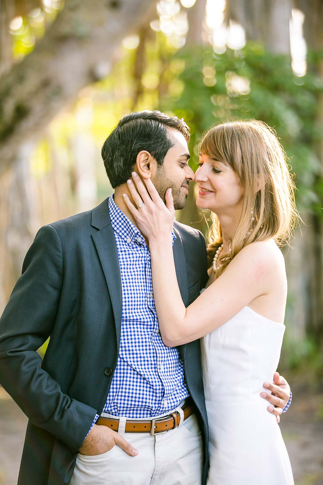indian groom and american woman pose for engagement photographs | fort lauderdale engagement photographer
