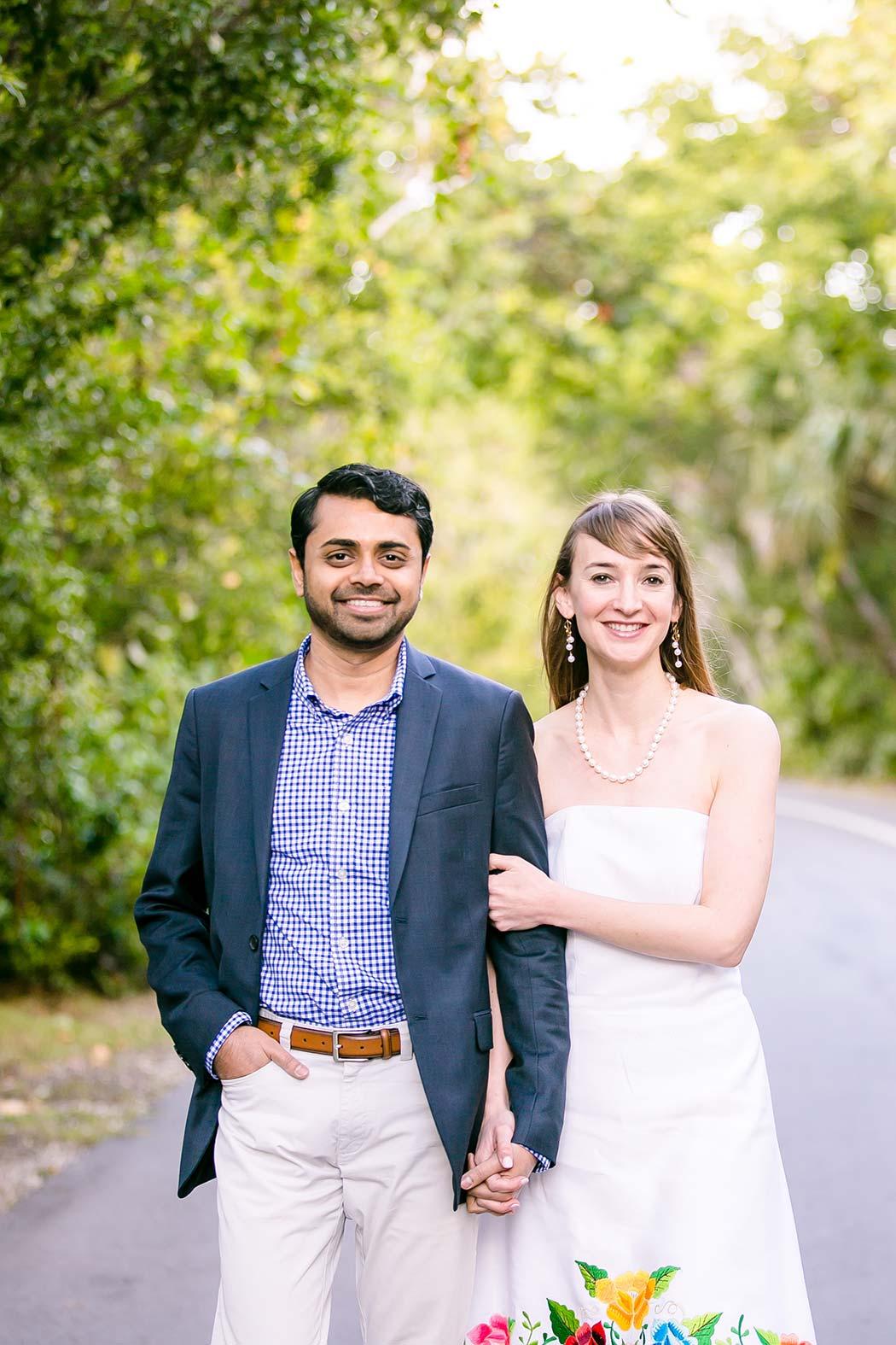 girl holds arm of fiance | unique engagement posing idea | indian couple's engagement photoshoot