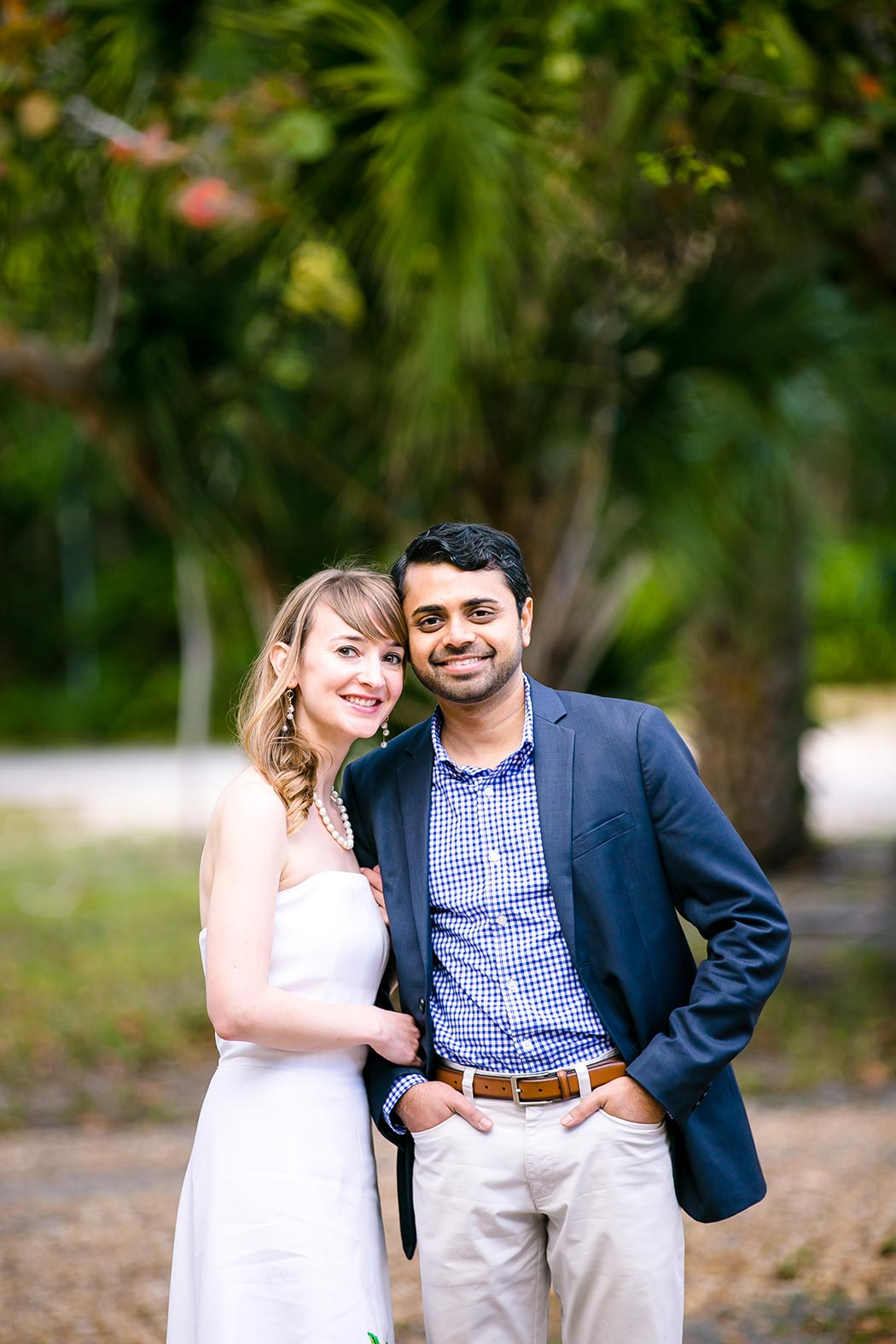 indian man and american woman embrace for fort lauderdale engagement photoshoot